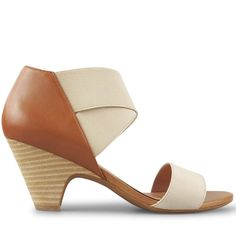 Crafted from supple tan leather and elastic, these versatile sandals have an ultra padded, contoured footbed that ensures a comfortable fit. With a raw stacked 7cm* cone heel, and crossed elastic strapping for a flattering, leg elongating silhouette, Sq