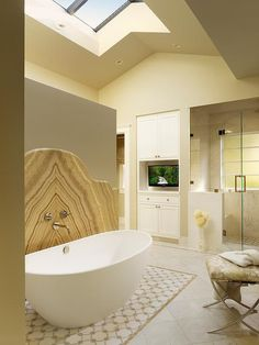 Coddington Design: The redesigned master bathroom features custom laser-cut floor tile and beautiful honey ...