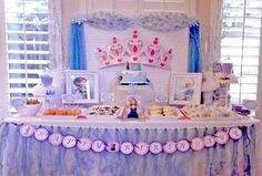 Pretty dessert table and backdrop at a Frozen birthday party! See more party ideas at CatchMyParty.com!