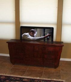 - DIY Project: Build Your Own Automated TV Lift DIY Project: Build Your Own Automated Hidden TV Lift! (It& actually more like you buy the arm lift kit, and then it shows you how to set it up to be hidden, still good to know though) Rustic Wood Cabinets, Diy Cabinets, Tv Storage, Storage Design, Record Storage, Hidden Storage, Home Improvement Projects, Home Projects, Hidden Tv Cabinet