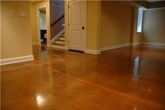Concrete stain instead of hardwood  -  maybe in the man cave???