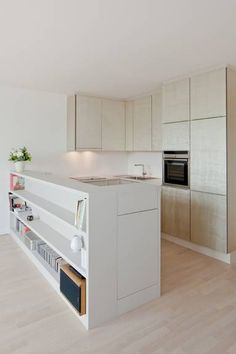 Light wood and white kitchen, love the central Island with enclosed bookshelves