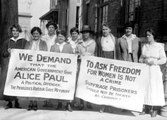 Lucy Branham (on left) and others protest the political imprisonment of Alice Paul with banners.  More about Alice Paul at http://www.alicepaul.org/alicepaul.htm