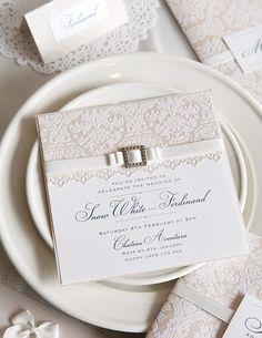 DIY Wedding invitation. i love the ribbon bow through the buckle idea.