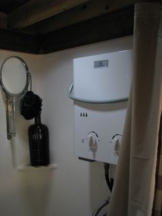 Austin's Tiny House - notes on safely using camping sized on demand water heater.