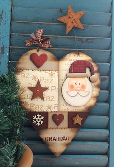 Prim hanging Christmas heart decorated with Santa, stars, mini hearts & a snowflake. Christmas Wood Crafts, Homemade Christmas Gifts, Primitive Christmas, Christmas Activities, Christmas Decorations, Christmas Ornaments, Christmas Hearts, Christmas Love, Christmas Signs
