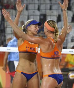 Madelein Meppelink (NED) of Netherlands and Marleen van Iersel (NED) of Netherlands celebrate. [REUTERS]