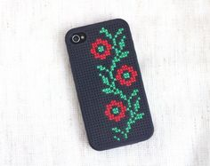 It is silicon rubber case for iPhone 4 or 4s. Ive decorated it with cross stitch ornament.    I try to do my best to represent the items true color in