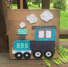 This cute train is ready to ship! Colors and wood stain are as shown! This would make a sweet baby shower gift or nursery decor! Shipping costs vary, so I will refund any shipping overages. Thank you for checking out my listing! You can find more at my Etsy shop- www.KiwiStrings.etsy.com