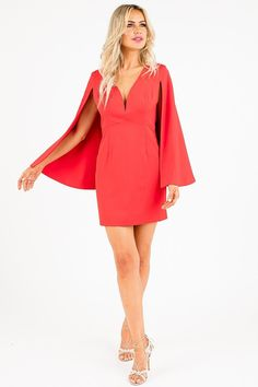 Be bold and beautiful in this bright red cape dress at your next soiree. This brilliant piece has a deep v-neck to show some skin and an on-trend cape detail at the back. An invisible zipper is located at the side for closure and supportive wire at the bust. There is no doubt that you will look red hot when showing off this smoking dress!