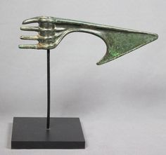 """LURISTAN BRONZE CEREMONIAL AXE HEAD, Ca. 1000-600 BCE;  A solid and sturdy bronze axe head, from Pre-Achaemenid Persia's Luristan Culture, with four """"butt spikes"""" extending from the axe's shaft hole in a form typical of Ceremonial Luristan Bronze Weapons."""