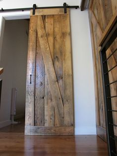 Sliding barn doors made from reclaimed wood. Use for bathroom door to replace that tight space in a small bath caused by standard doors?