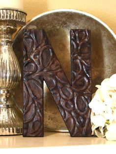 A cardboard letter, Elmers glue, aluminum foil and paint= Awesome DIY letter on the cheap!...has a link on her website to the tutorial....