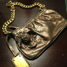 Dolce and gabbana bronze handbag ... 8 inch x 5 inch bronze soft calfskin leather back flower detail., bronze chain 18 inch chain Dolce & Gabbana Bags