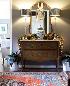 Gorgeous! entry table decor- thrifted dresser at the entry way instead of the bedroom!