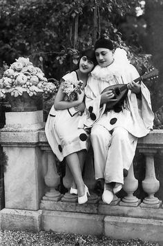 Pierrot playing a mandolin for a pierrette.