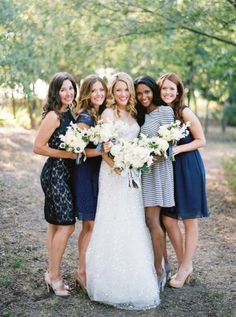 mix of lace, stripes, and silk chiffon in blue bridesmaid dresses