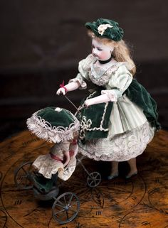 "Rare French Bisque Mechanical toy doll ""Lady with Mignonette and Carriage"" - Vichy with F.Gaultier head."