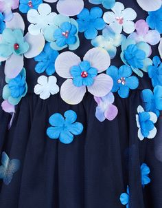 Hand-embellished over 50 minutes using traditional artisanal techniques, our Bessey party dress for girls is bestrewn with 3D flowers with sparkling sequins. Fully-lined for a comfy fit, this pretty piece has a softly-gathered tulle skirt and a tie-up bow on the back.