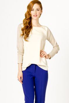 this cream sweater with a bold pant color is classy and super stylish