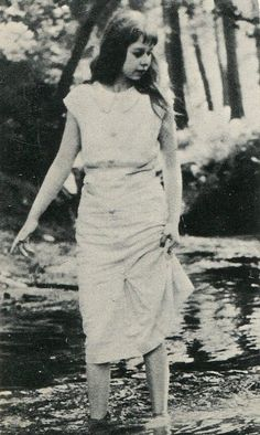 Carson McCullers paddling in a stream