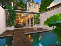 Pool off casual entertaining area - love the indoor outdoor living and colour of the water!
