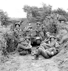 Canadian soldiers resting after fighting for Juno, 6 June 1944