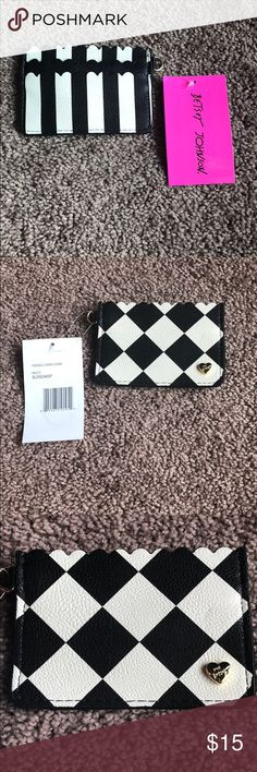 NWT BETSEY JOHNSON credit card holder NWT!!   Super cute black and white Betsey Johnson Credit Card holder. Has 3 skits for cards. Inside with red roses. Betsey Johnson Accessories Key & Card Holders