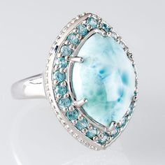 This ring combines the beauty of both the sea and sky. Larimar, this unique blue gem, was formed as a result of volcanic activity millions of years ago that created the Caribbean island of Hispaola.  It's truly island inspired! || Marquise Larimar With .94ctw Round Blue Apatite Sterling Silver Ring [Promotional Pin]