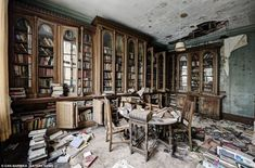 Hundreds of books have been left on the shelves and the floor in this but abandoned UK manor house