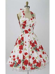 "The perfect pretty red rose print vintage style dress for upcoming spring and summer garden parties, weddings, dances  and dinner dates! The ""Varga"" by Trashy Diva is a 50s feminine silhouette with fitted halter style sweetheart bodice,  gathered bust overlay and full circle swing skirt."