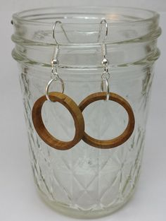 Handmade Hawthorne hoop earrings, sealed with beeswax to enhance their natural beauty and protect the wood.  www.mackeyartistry.etsy.com  #MackeyArtistry