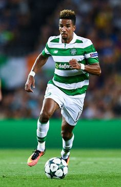 Scott Sinclair of Celtic FC runs with the ball during the UEFA Champions League Group C match between FC Barcelona and Celtic FC at Camp Nou on September 13, 2016 in Barcelona, Catalonia.
