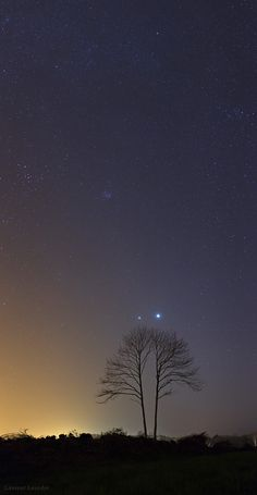 As appeared on National Geographic News the two brightest planets of the night sky, Venus (the brighter) and Jupiter, meet in the evening sky of Brittany, France. Click on the star-pattern icon above the image to see a different version of this image, using a star filter. The beautiful planetary conjunction was an eye-catching view from all around the planet during March 2012. Laurent Laveder/Pixheaven.net
