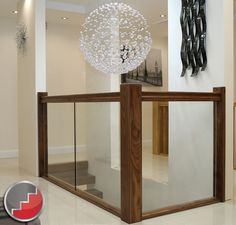 I love the Black walnut handrail and newel posts with the Glass Balustrading