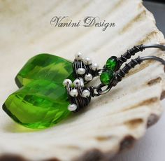 Beautiful and feminine earrings featuring Green peridot quartz ,chrome diopside and pearls in handmade Fine and sterling silver wire work.
