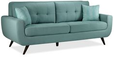 Ahead of the Curve. The Julian sofa offers a modern update to classic mid-century modern furniture design. Featuring an on-trend, light-bluish teal finish, the well-tailored, durable fabric presents a stunning pop of colour that you can decorate around while injecting a dose of subtle panache. Loose seat cushions promote longevity, as they can be rotated for even wear. The mid-century hallmarks of a curved silhouette, track arms, grid-like tufting and flared, richly coloured legs all combine…