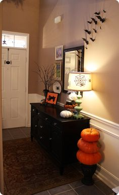Thrifty Decor Chick: So cheap it's scary  The whole look was around ten dollars. I love the bat cut outs.....This has great ideas.