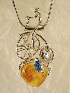 Pendant 2102, Gregory Pyra Piro one of a kind pendant, solid gold and sterling silver, Swiss blue topaz, Baltic amber