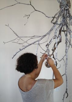 Either leave natural or spray branches and twigs your colour of choice and tie into a bundle and suspend from the ceiling. Decorate...or not.