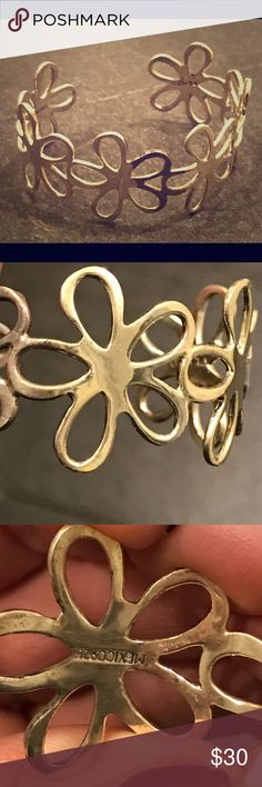 Silver cuff of daisies🌼🌼 Six silver daisies formed into a beautiful cuff. Purchased impulsively in Mexico four years ago and worn only once. No scratches, excellent condition. Strong, but also bendable enough to adjust fit. Jewelry Bracelets