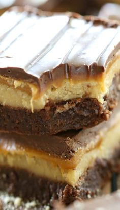 Twix Truffle Brownies ~ fudgy chocolate brownie topped with a shortbread cookie truffle, gooey caramel and melted chocolate… its pretty amazing