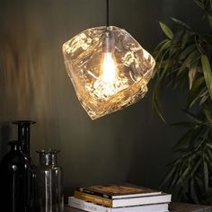 This Rock ceiling light is a real eye-catcher! The ceiling light is in the shape of a rock and is made out of mouth blown glass. Rock Lamp, Industrial Ceiling Lights, Lamp, Light, Pendant Light, Glass Blowing, Mouth Blown Glass, Cool Lamps, Ceiling Lights