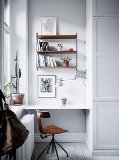 Workspace nook with String shelves.