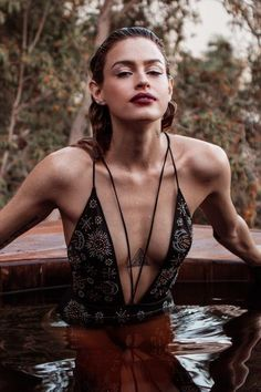 Feel the magic in this starry skied one piece! Perfect for holiday jacuzzi celebrations, or for wear as a bodysuit under more revealing blouses. Features criss