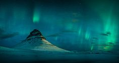... magic Kirkjufell - It was a magic night, when I arrived in iceland. The clear was clear, the air cold and there was a good aurora forecast! So I drove to the Kirkjufell area and captured this shot. It is a panorama stitched from 6 single exposures.
