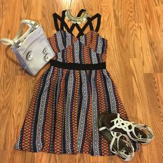 EZRA, NWOT SZ M, GORGEOUS CROSS STRAP LINED DRESS  EZRA, NWOT, SIZE MEDIUM CROSS STRAP SUMMER DRESS! FULLY LINED, ABSOLUTELY GORGEOUS, SUPER EASY TO WEAR DRESS! 95% POLY/5% SPANDEX! ZIPPER IN BACK MIDDLE.  BLUE, ORANGE, WHITE, WITH SPLASHES OF PURPLE, PINK, TAUPE Ezra Dresses Mini