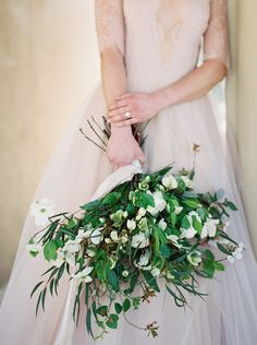 Green and white wedding bouquet from a peaceful bridal portrait on her wedding day.  #elegantbridalportraits  #bridalportraitphotographs  #bridalportraitposes