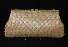 Today's favourite: Beautiful 1950's Harrods Rhinestone Encrusted Evening Bag, £75 by @allthatvintage. Goldtone Mesh Material studded with sparkling Rhinestones. Quality piece with the top clasp bar being topped with two large rhinestones that are set in filigree and surrounded by prong set rhinestones and small cream beads. Goldtone chain handle...