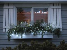 Christmas window – love the lights but I'd add in red accents. Christmas window – love the lights but I'd add in red accents. Christmas Window Boxes, Winter Window Boxes, Christmas Urns, Christmas Planters, Outdoor Christmas Decorations, Christmas Lights, Silver Christmas, Holiday Lights, Winter Planter